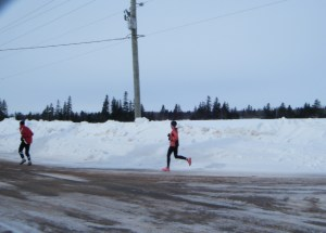 Winter Half marathon runners surrounded by snowbanks
