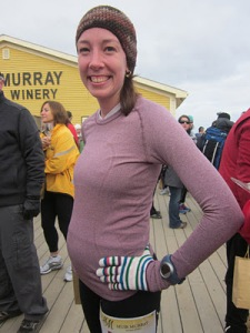 a pregnant runner at a race