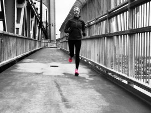 runner on MacDonald Bridge in Halifax, NS