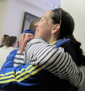 husband and wife embrace after Boston Marathon 2011